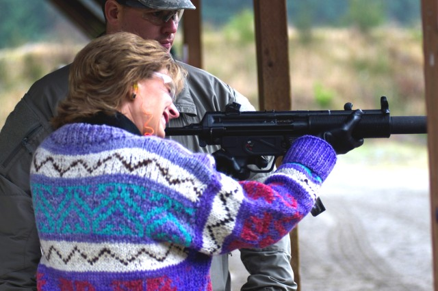 A 1st Special Forces Group family member fires a few rounds on automatic at Flat Range Complex at Joint Base Lewis-McChord, Wash., Dec. 7, 2011.