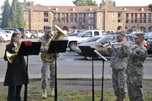 """JOINT BASE LEWIS-McCHORD, Wash. """" Soldiers and family from the 56th Army Band play holiday carols for I Corps' Special Troops Battalion on Joint Base Lewis-McChord 13 Dec. to show their appreciation for the STB's support throughout the year. The members of the quartet, from left to right, are Barbara Hite, Sgt. 1st Class Christopher Hite, Staff Sgt. Luis Ortiz and Sgt. 1st Class Dwain Graham. (Army photo by Sgt. James Hale)"""