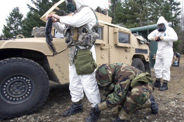 Soldiers from 3rd Explosive Ordnance Disposal Battalion suit up prior to training Dec. 5, 2011, at Joint Base Lewis-McChord, Wash., to be certified as EOD team leaders.