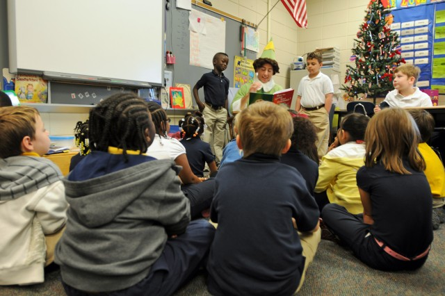 First Lt. David M. Vogt, an ordnance officer with Headquarters and Headquarters Company, 703rd Brigade Support Battalion, 4th Infantry Brigade Combat Team, 3rd Infantry Division, reads a Christmas story to students in the first grade at Liberty Elementary in Midway, Ga., Dec. 14, 2011, as part of the battalion's school outreach program.
