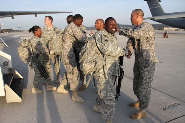 Soldiers return from Afghanistan earlier this year.  Reserve-component Soldiers returning over the next weeks from Afghanistan and Iraq will need to complete a full demobilization process, but officials have promised a four-day holiday pass.