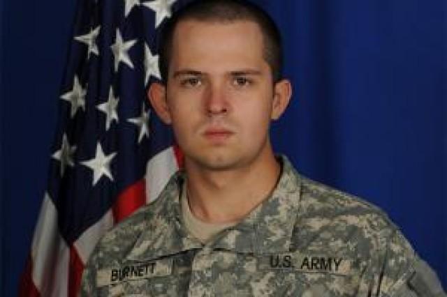 Spc. James R. Burnett Jr., of Wichita, Kan., (shown as Pfc. Burnett in courtesy photo) was killed Nov. 16, 2011, when his vehicle struck an improvised explosive device.