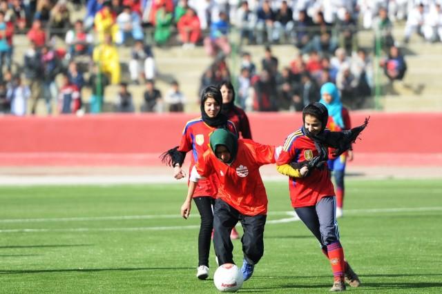 Female teams helped break in Ghazi Stadium in Kabul, Afghanistan, after the ribbon-cutting ceremony Dec. 15, 2011.