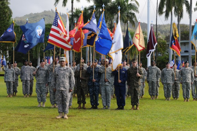 "Command Sgt. Maj. Iuniasolua T. Savusa (center), the U.S. Pacific Command's senior enlisted leader was honored with a Flying ""V"" ceremony held Dec. 19 at Fort Shafter's historic Palm Circle."