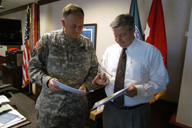 Aviation and Missile Command commander Maj. Gen. Jim Rogers reviews with his deputy Ronnie Chronister some of the findings from a trip to visit Soldier units in the Asia-Pacific region that are supported by the command.