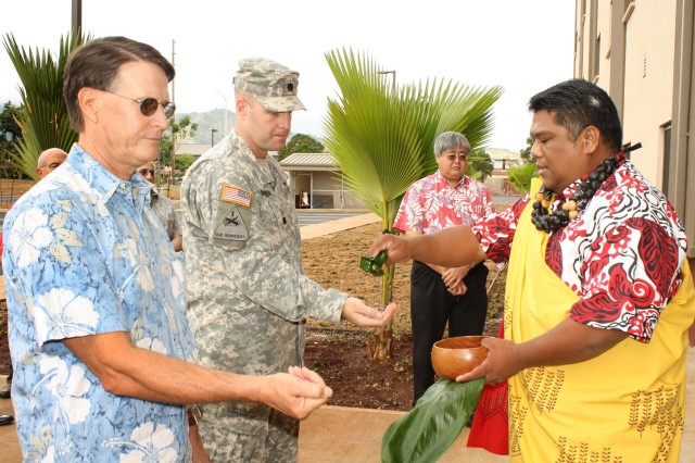 Directorate of Public Works Director Bob Eastwood and Honolulu District Commander Lt. Col. Douglas Guttormsen participate in a traditional maile lei untying and blessing ceremony held Dec. 15, 2011, for the new Unaccompanied Enlisted Personnel Housing at Schofield Barracks, Hawaii.