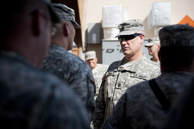 Sgt. Maj. of the Army Raymond F. Chandler III visits the 1st Battalion, 161st Field Artillery, Kansas Army National Guard, during his visit to Camp Lemonnier, Djibouti, Dec. 16, 2011. Chandler talked to the Soldiers about their home life and their views on their deployment.