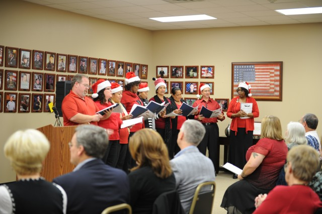 Members of the Army Community Services choir perform Christmas carols during the Survivor Outreach Services holiday reception Dec. 15, 2011, in the SOS Center's Hall of Remembrance at Fort Hood, Texas. A few dozen family members of fallen service members attended the reception, which also included food, fellowship and remarks from Marine widow Malia Fry and III Corps and Fort Hood Commanding General Lt. Gen. Don Campbell Jr.