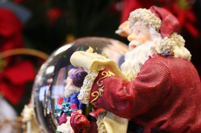Elaine Waldrep's, executive assitant to the commanding general of the U.S. Army Space and Missile Defense Command/Army Forces Strategic Command, Santa snowglobe stands sentry on her desk welcoming all who enter the command leadership office area.