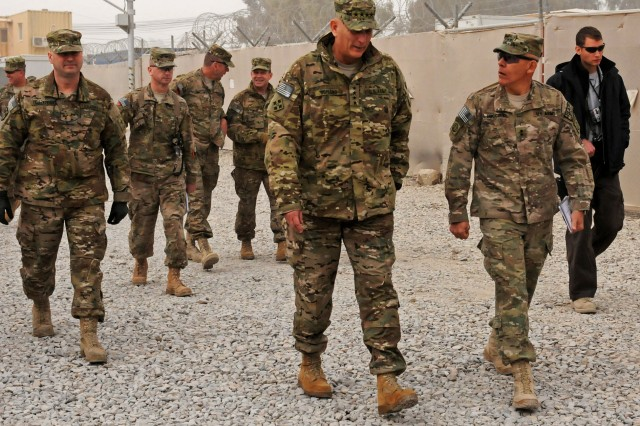 Army Gen. Raymond T. Odierno, Chief of Staff of the Army, walks alongside Maj. Gen. Jim Huggins, 82nd Airborne Division and Regional Command (South) commanding general, after a working breakfast with all of the task force commanders and command sergeants major, as well as the headquarters command staff, on Kandahar Airfield Dec. 21. Odierno visited the region to meet with task force and headquarters leadership, talk to service members, and assess the current situation in the battle space.
