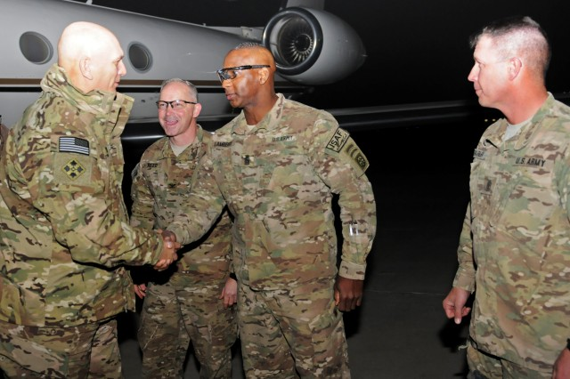 Army Gen. Raymond T. Odierno, Chief of Staff of the Army, is greeted by Command Sgt. Maj. Bryant C. Lambert, 82nd Airborne Division and Regional Command (South) command sergeant major, as Col. Karl D. Reed, 82nd Airborne Division and RC(S) chief of staff, and Command Sgt. Maj. Michael L. Shirley, Kandahar Airfield command sergeant major, look on as Odierno arrives on Kandahar Airfield Dec. 20. Odierno visited the region to meet with task force and headquarters leadership, talk to service members, and assess the current situation in the battle space.