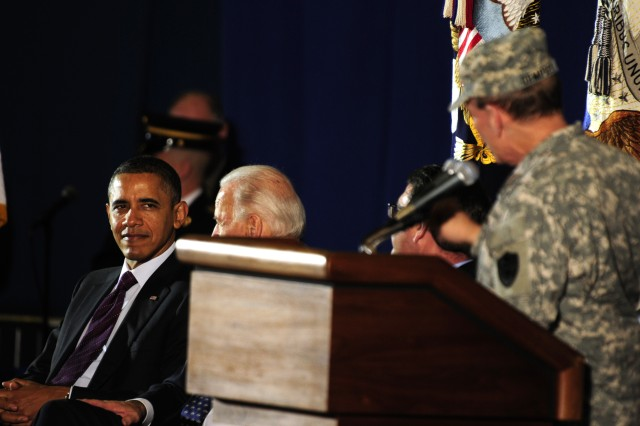 The President of the United States, Barack Obama, Vice President Joe Biden, The Honorable Ashton B. Carter, Deputy Secretary of Defense, and General Martin E. Dempsey, Chairman of the Joint Chiefs of Staff, give a standing ovation to General Lloyd Austin III, Commander of the U.S. Forces Iraq, as he take the podium during a ceremony held for the returning of the U.S. Forces Iraq Colors at Andrews Air Force Base, Md., Dec. 20, 2011. The command colors being returned back on American soil represents the end of the 8-year war in Iraq and the return of all troops back home. (U.S. Army Photo by Sgt. Jose A. Torres Jr.)