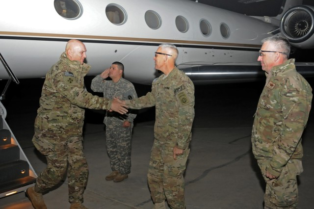 Army Chief of Staff Gen. Raymond T. Odierno greets Maj. Gen. Jim Huggins, 82nd Airborne Division and Regional Command (South) commanding general, as Air Force Brig. Gen. Scott L. Dennis, Kandahar Airfield commanding general looks on. Odierno visited south Afghanistan Dec. 20-21 to meet with task force and headquarters leadership and talk with Soldiers.