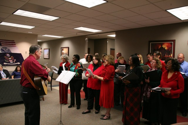 The U.S. Army Space and Missile Defense Command/Army Forces Strategic Command Holiday Choir performed during closing ceremonies of the Holiday Party Dec. 20.
