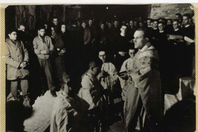 Original photos of the Mass held December 24, 1944 in the De Schark Cave, Maastricht, Netherlands. Photo courtesy of the Foundation of the Commemoration of the American Christmas Celebration 1944.  Read more here: http://www.army.mil/article/71287/