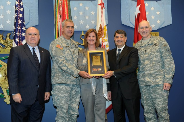 PEO AMMUNITION WINS LEAP AWARD: From left, Joseph Westphal, Under Secretary of the Army; Brig. Gen. Jonathan Maddux ,Commander, PEO Ammunition; Barbara Gabbard ,PEO-Ammunition LSS Deployment Director; Paul Chiodo, ARDEC LSS Deployment Director and Lt. Gen. William Grisoli, Director of U.S. Army Office of Business Transformation.