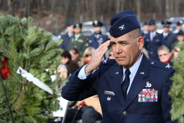 Col. Victor Rodriguez, U.S. Air Force, salutes as wreaths are laid in honor of fallen New Jersey service members Dec. 10 during a Wreaths Across America ceremony.