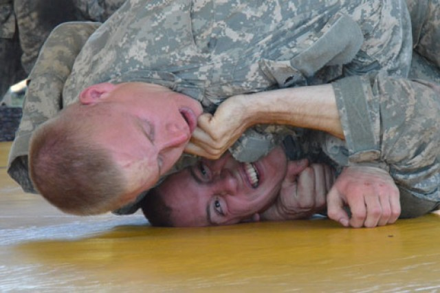 Spc. Casey Hargaden, National Capital Region, holds Staff Sgt. Sean Swint, Eighth U.S. Army, in check during the non-evaluated combatives tournament.
