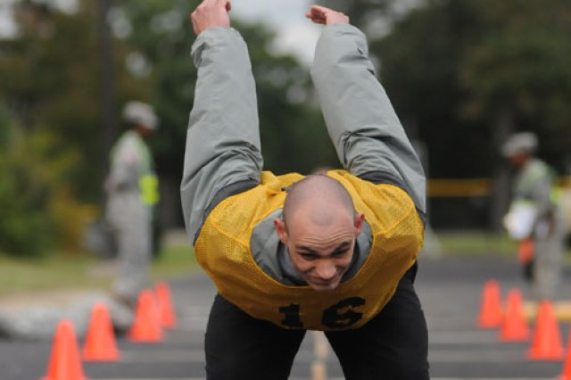 Spc. Brandon Kitchen, U.S. Army Space and Missile Defense Command, gets set for the standing long jump event of the Army Physical Readiness Test. The APRT was a demonstration event and was not evaluated.