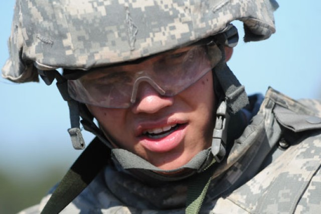 Spc. Zachary Liermann, U.S. Army Special Operations Command, catches his breath after completing one of Warrior Tasks and Battle Drills at the 2011 Best Warrior Competition.