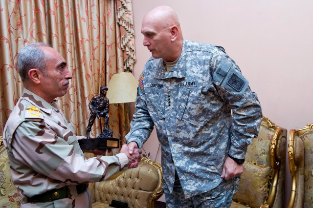 Army Chief of Staff Gen. Raymond T. Odierno, right, presents a Soldier statue to Iraqi Gen. Babakir Zebari for his continued support and strong partnership with U.S. Forces in Iraq during a visit to Baghdad, Dec. 22, 2011.