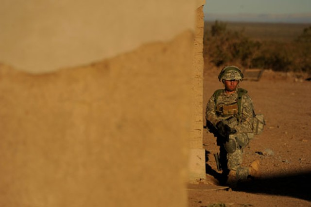 After receiving orders from his chain of command through a mobile digital system, a Soldier from 1st Squadron, 1st Cavalry Regiment, 2nd Brigade Combat Team, 1st Armored Division, prepares to enter a military operations in urban terrain site at White Sands Missile Range, N.M.