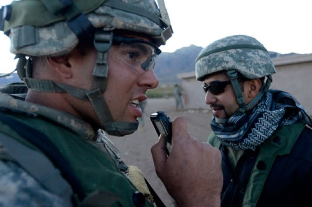 "2nd Lt. Adam Martin, a platoon leader with 1st Squadron, 1st Cavalry Regiment, 2nd Brigade Combat Team, 1st Armored Division, collects information from a suspected ""insurgent,"" and instantaneously relays the details to his chain of command through a hand-held device. The 2nd BCT has approximately 3,800 Soldiers who spent three weeks in November testing and evaluating dozens of digital systems that could give Soldiers a future tactical edge, during an exercise called the Network Integration Evaluation 12.1."