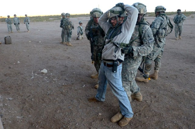"An ""insurgent"" is detained by Soldiers from 1st Squadron, 1st Cavalry Regiment, 2nd Brigade Combat Team, 1st Armored Division, at a military operations in urban terrain building at White Sands Missile Range, N.M."