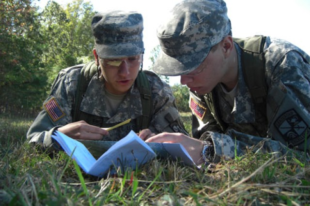 ROTC Cadets Alexander Downes (left) and Derek Blakeman from the University of Maryland's Terrapin Battalion practice land navigation during Operation Fire and Maneuver, a field exercise held on Fort A.P. Hill, Va., in October 2010.