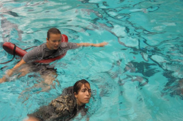 Cadets Mariya Golotyuk (top) and Catherine Gonzalez from the University of Maryland's ROTC battalion practice water safety at the university's Eppley Recreational Center pool in College Park, Md., September 2011. When this photo was taken, Golotyuk was the cadet battalion commander. She also ranked as the top cadet in the nation during the 2011-2012 academic year.