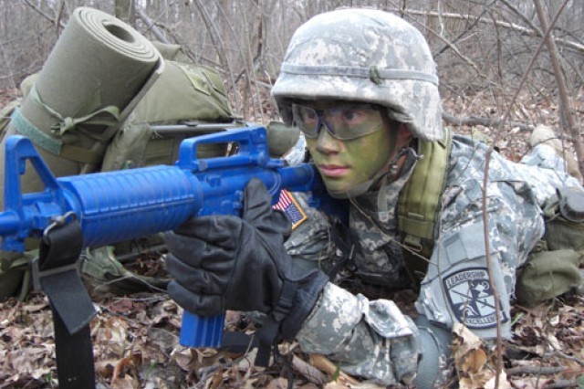 Cadet Lawrence Hsieh of the University of Maryland ROTC battalion pulls security on the perimeter of a patrol base during a squad tactics exercise at Acredale Park in College Park, Md., in March 2011.