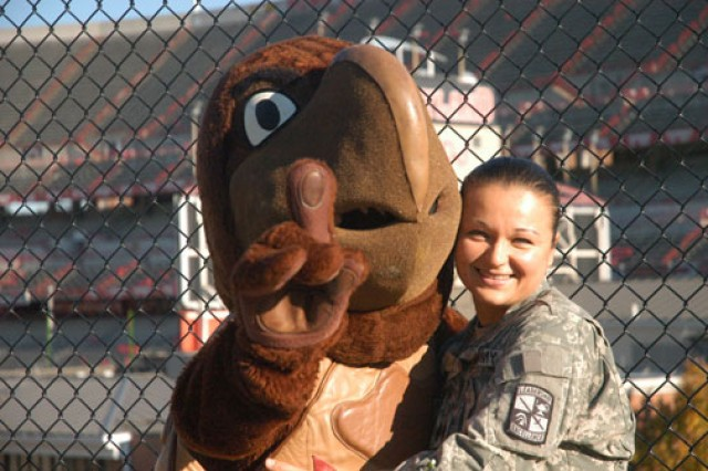 "Cadet Mariya Golotyuk, cadet battalion commander at the University of Maryland ROTC detachment, hugs the school's Terrapin mascot in front of the stadium on the College Park, Md., campus. Born in a ""small, gray Soviet town"" in Ukraine, Golotyuk is eager to serve the country that has given her so much. Through hard work and perseverance, she earned the highest cadet ranking at Cadet Command's 2011 Leader Development and Assessment Course. She will branch military intelligence when she graduates from Maryland's graduate accounting program in spring 2012."