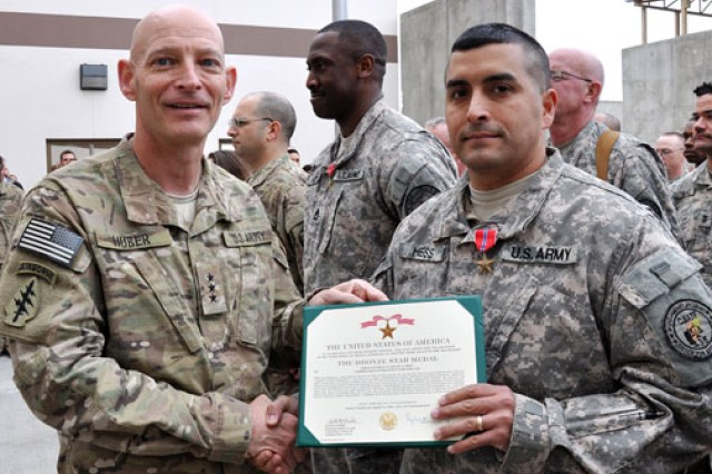 Lt. Gen. Keith M. Huber, commander, Combined Joint Interagency Task Force 435, presents Sgt. 1st Class Leo Hess with the Bronze Star medal during a ceremony in Afghanistan. Hess traveled to Washington, D.C., in September to honor his hometown with the Employers Support of the Guard and Reserve Freedom Award for supporting him while deployed. He said the community's support for his family while he was in Afghanistan allowed him to successfully do his mission.
