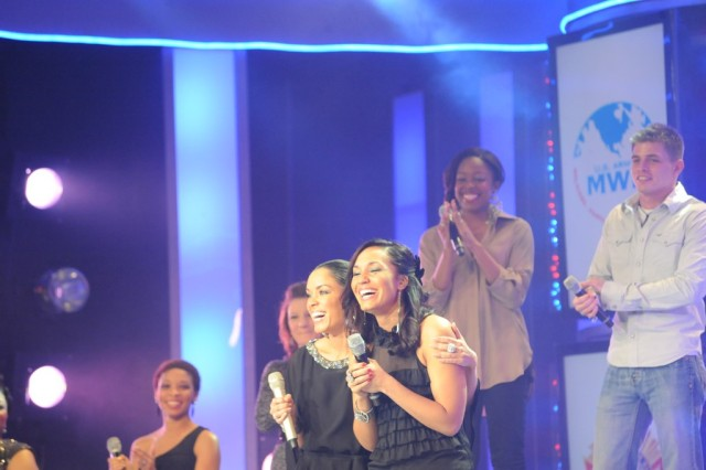 U.S. Army Reserve Sgt. Melissa Neal (right), a former active duty Soldier and current Army wife and mother, smiles after winning the 2011 Operation Rising Star singing contest at Fort Sam Houston, Texas, while host GeNienne Samuels gives her a hug.