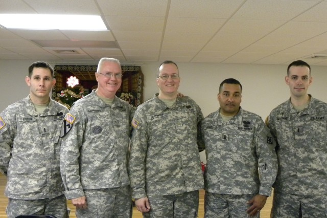 412th Theater Engineer Command deputy commannder Brig. Gen. Douglas R. Satterfield thanked 365th Engineer Battalion commander Lt. Col. Michael Trofinoff and his team for a great year during the unit's Family Day and Holiday celebration Dec. 11, 2011, Schuylkill, Pa. (Photo: 2nd Lt. Renee Zimmerman)