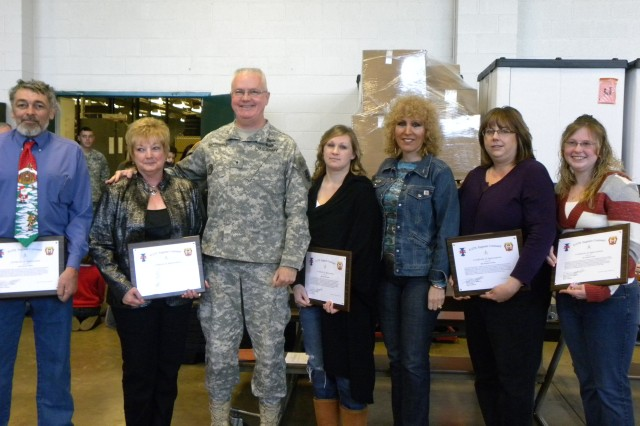Brig. Gen. Douglas R. Satterfield, deputy commander of the 412th Theater Engineer Command, and wife Nancy (third from right) recognized several Soldiers, Family members and community leaders for volunteerism and partnership with the unit throughout the year during the 365th Engineer Battalion's Battle Assembly and Holiday celebration Dec. 11, 2011, Schuylkill Haven, Pa. (Photo: 2nd Lt. Renee Zimmerman)
