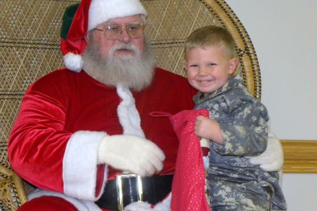Santa was a big hit with 3-year old Gage Bacon, son of Chief Warrant Officer Corrie Bacon, during the 365th Engineer Battalion's Family Day and Christmas celebration Dec. 11, 2011, Schuylkill, Pa. (Photo: 2nd Lt. Renee Zimmerman)