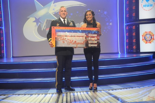 U.S. Army Reserve Sgt. Melissa Neal (right), a former active duty Soldier and current Army wife and mother, poses with Lt. Gen. Mike Ferriter, commanding general, Installation Management Command, after winning the 2011 Operation Rising Star singing contest at Fort Sam Houston.
