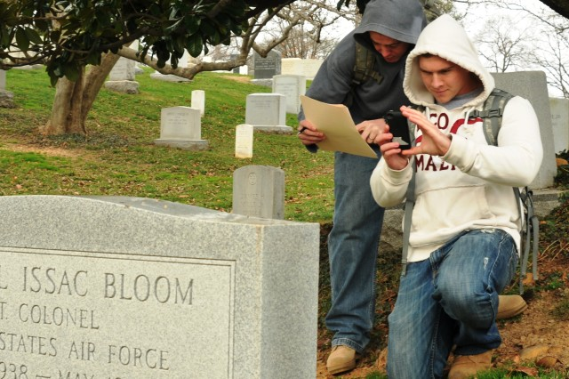 Sgt. Bryan Wahls (left) and Pfc. Stephen Dynn (right), infantrymen with Delta Company, 1st Battalion, 3d U.S. Infantry Regiment (The Old Guard), verify and photograph a tombstone in Arlington National Cemetery, Va., Dec. 15, 2011. They were part of Task Force Christman, which photographed and documented more than 259,000 tombstones, grave markers and cremation sites to verify and update all burial records in the cemetery.