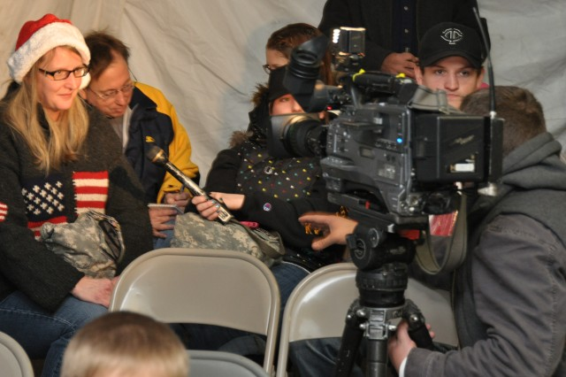 Patti Garrick, mother of Spc. Matt Garrick, 3rd Brigade Special Troops Battalion, 3rd Brigade Combat Team, 1st Cavalry Division, answers questions for a television interview in the warming tent next to Cooper Field on Fort Hood, Texas, Dec. 24, 2011. Garrick traveled from Hastings, Minn., to meet her son at the Christmas Eve redeployment ceremony.