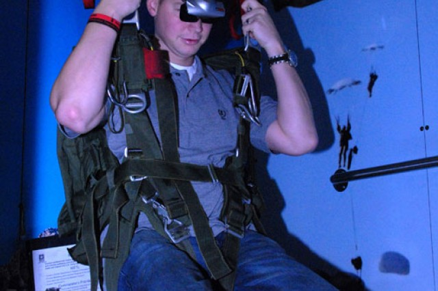 Arthur Ford braves the parachute simulator on the AS2 during the Army Ten Miler Expo at the D.C. Armory in Washington, Oct. 8, 2011.