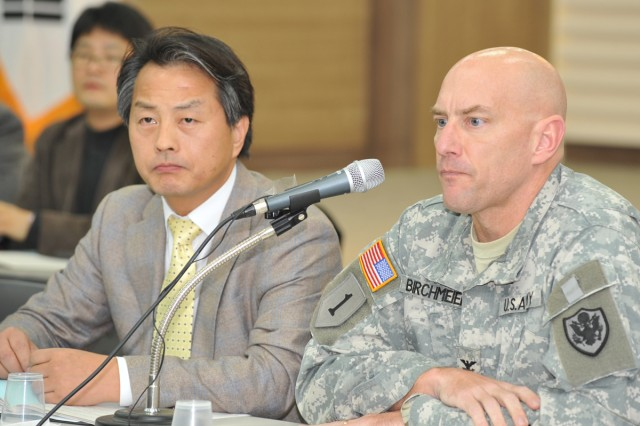 Lead South Korean Investigator Doctor Gon Ok (left) and Lead U.S. Investigator Col. Joseph F. Birchmeier listen to a question during the press conference at the Chilgok County Office, South Korea, Dec. 29, 2011.
