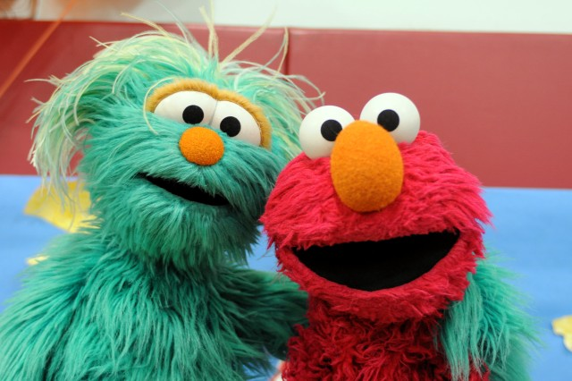 "Sesame Street Muppets ""Rosita"" and ""Elmo"" at Logan School Age Services Dec. 16. Sesame Street was on Fort Bliss to inform families of its ""Talk, Listen, Connect"" program, which helps military families and their children deal with issues that may be difficult to communicate about."