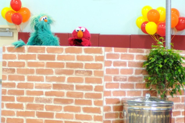 "Sesame Street Muppets ""Rosita"" and ""Elmo"" perform for military families at Logan School Age Services Dec. 16. Sesame Street was on Fort Bliss to inform families of its ""Talk, Listen, Connect"" program, which helps military families and their children deal with issues that may be difficult to communicate about."