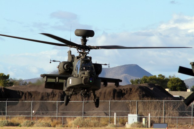 Chief Warrant Officer 2 Shawn Witt lifts off in an AH-64D Apache Block III helicopter from Boeing's flight line in Mesa, Ariz.