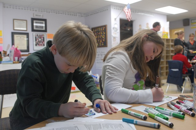 Lausanne Collegiate School students spent their final day before the school's holiday break to sort care packages and write letters to their 'adopted' troops in Afghanistan, the men and women of the 689th Engineer Company. (Photo: Capt. Maryjane Porter)