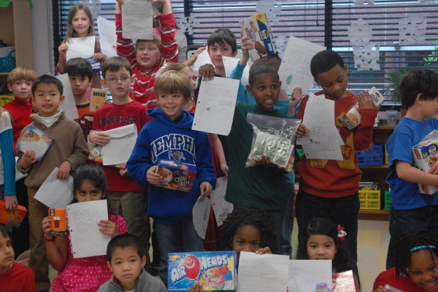 2nd graders at Lausanne Collegiate School spent their final day before the school's holiday break to sort care packages and write letters to their 'adopted' troops in Afghanistan, the men and women of the 689th Engineer Company.