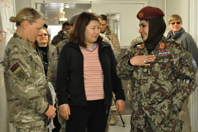 Brig. Gen. Khatool Mohammadzai, (right) director for women's affairs in the Afghan National Army, and for physical training of recruits, visits with Marine Maj. Gen. Angela Salinas (left) and consults with several Afghan women as part of a leadership forum.