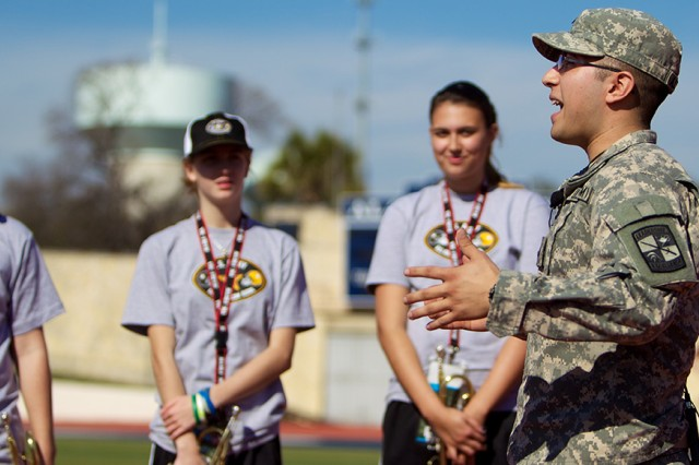 Cadet Abel Alvarado speaks Wednesday to trumpet players in the All-American Bowl marching band about sharing their experiences in San Antonio with students back home.