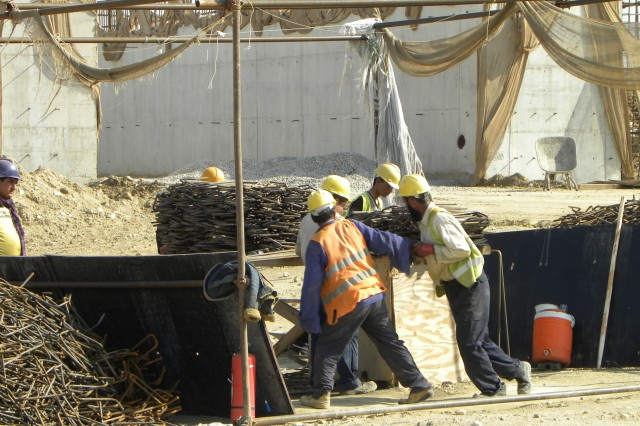 Construction workers shape rebar used to build the ammunition bunkers in northern Afghanistan.